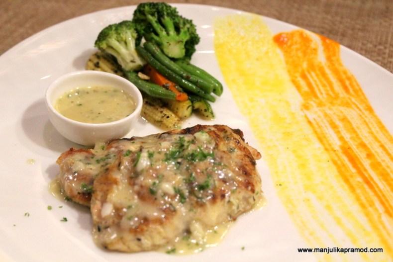 Panseared fish, Sauteed vegetables, lemon butter sauce