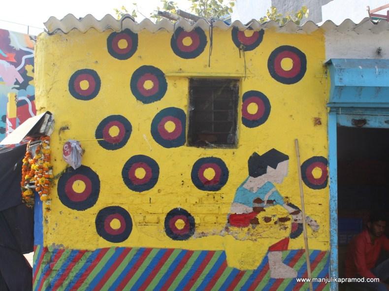 Wall art of a Koli women