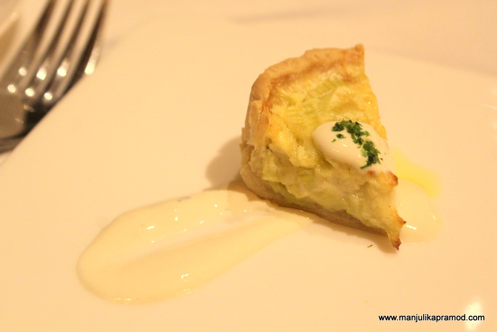 Cheese and leeks quiche with melted mild gorgonzola.