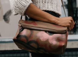 lady holding a leather bag
