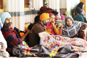 Flood victims take shelter in a relief cam at a gurdwara in Srinagar