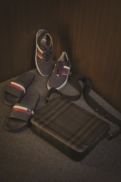 PAUL & SHARK Casual blue and red striped Plimsol sneakers with worn out blue finish; LOUIS VUITTON Beach slip-ons; BURBERRY Leather sling bag