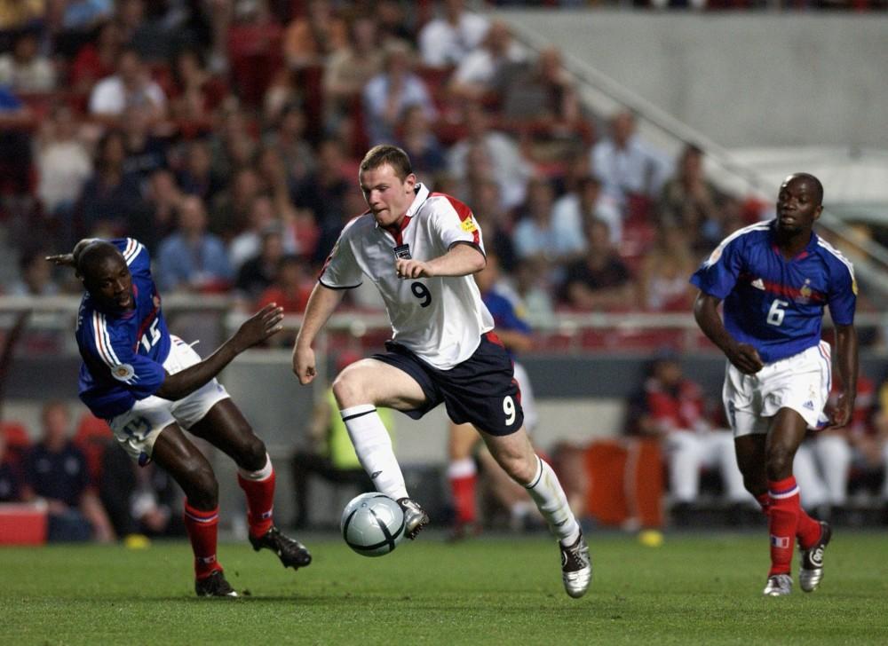 Sport, Football, UEFA European Championships, Euro 2004, Estadio Da Luz, Lisbon, 13th June 2004, France 2 v England 1, England's Wayne Rooney moves past France's Lilian Thuram  (Photo by Bob Thomas/Getty Images)