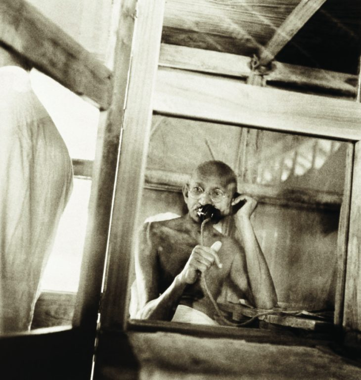 Gandhi telephoning from the office hut, Sevagram Ashram