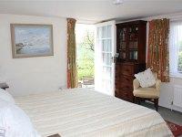Garden apartment bedroom - Manton Lodge Self Catering Rutland