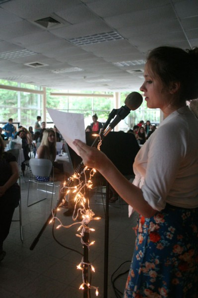 Sadie Birchfield (12) announces the next presenter for One Blue Wall's Open Mic Night. Photo by Miracle Stewart