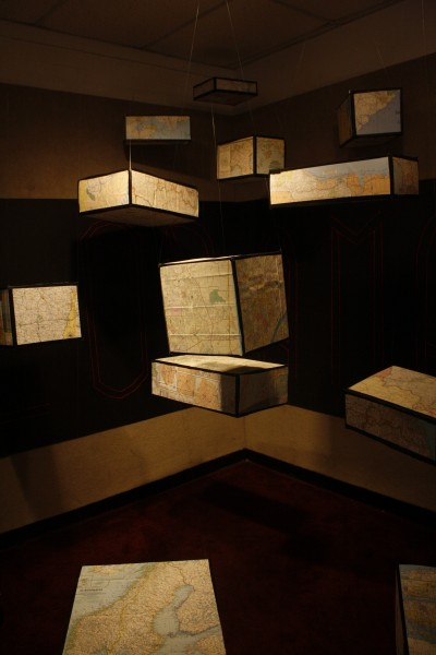 "Boxes with maps of the world hung from the ceiling in the spirit of the theme which was ""Explorama."""