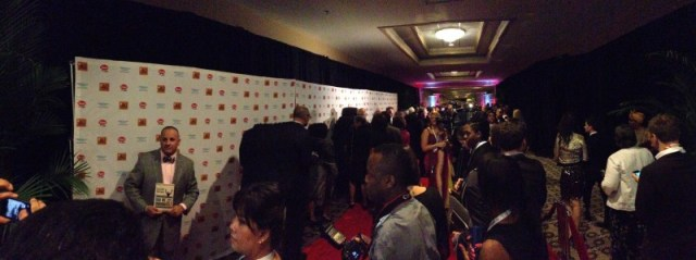 Guests and journalists wait on the red carpet before the main program
