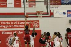 Tonysha Curry (11, ##23)showcasing her athleticism with one of her many second-chance layups.