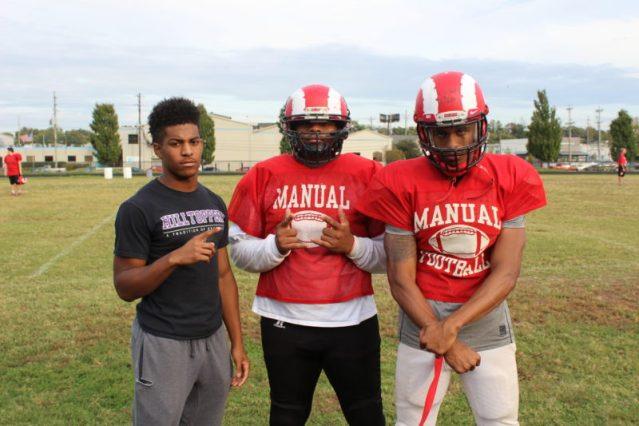 After practice Bryce Cosby (7, 12), Sean Cleasant (98, 12) and Jaelin Carter (11, 12) pose for a photo. Photo by Olivia Evans.