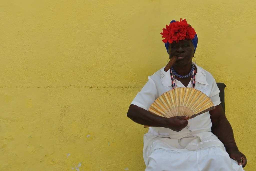 Cuban woman smoking a cigar in Havana Vieja