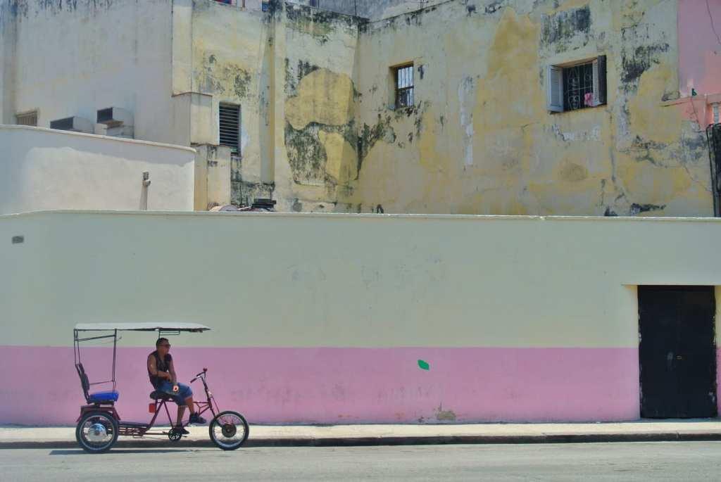 bicycle taxi outside Museo de la Revolución in Havana, Cuba