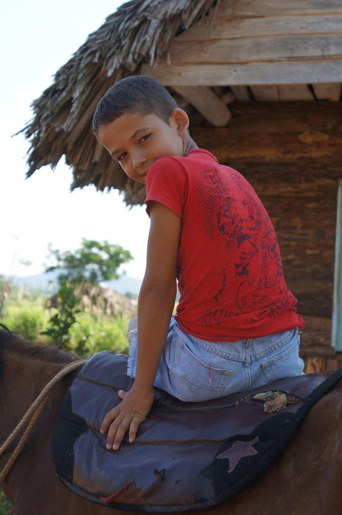 a boy on horseback in vinales