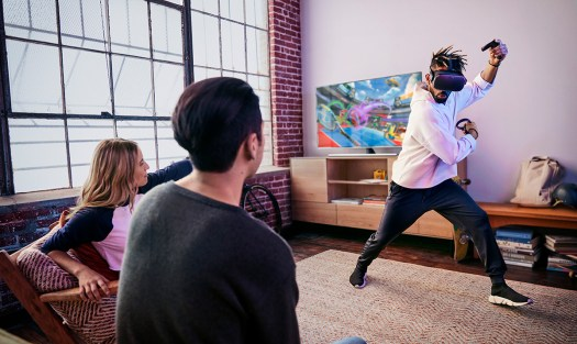 Three people play Oculus Quest