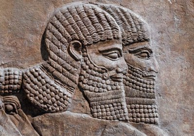 history of asia dates back to stone carving etched to represent the Assyrian warriors