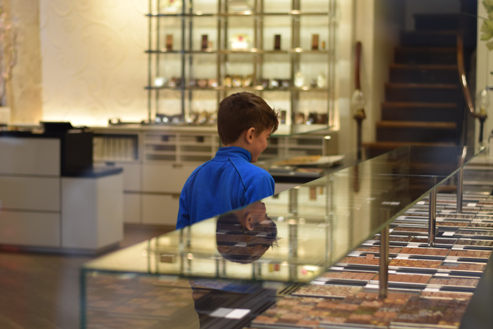 A boy selecting chocolates in Jaques Genin, Paris.