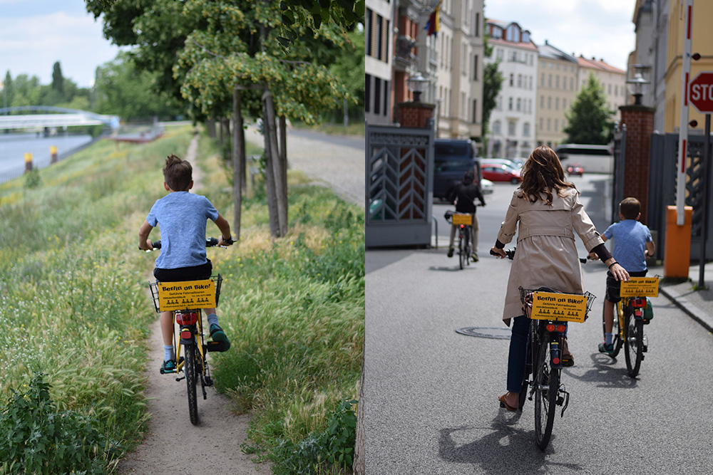 A photo of a boy riding a bike on a dirt path near the Spree River in Berlin, Germany. A photo of a mother and children on a bike tour of the Berlin Wall.