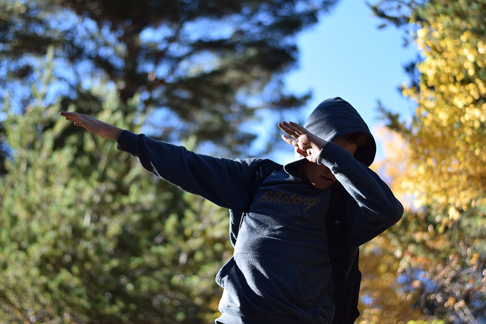 "Photo of a teenage boy ""dabbing"" after a hike through the Pyrenees of Spain."