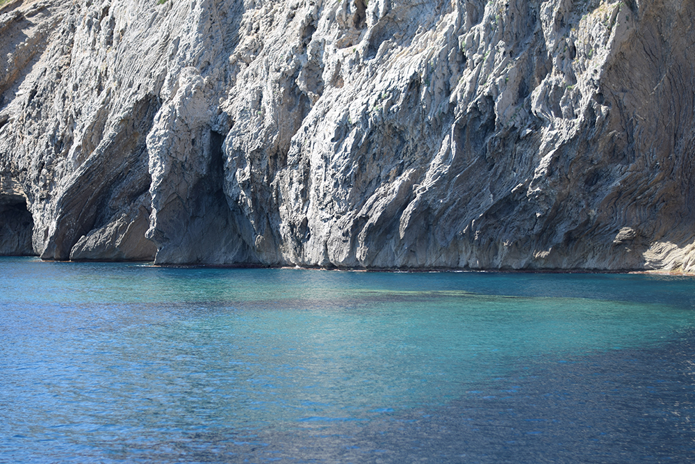 A photo of beautiful blue waters and white cliffs in Cap Formentor, Mallorca, Spain.