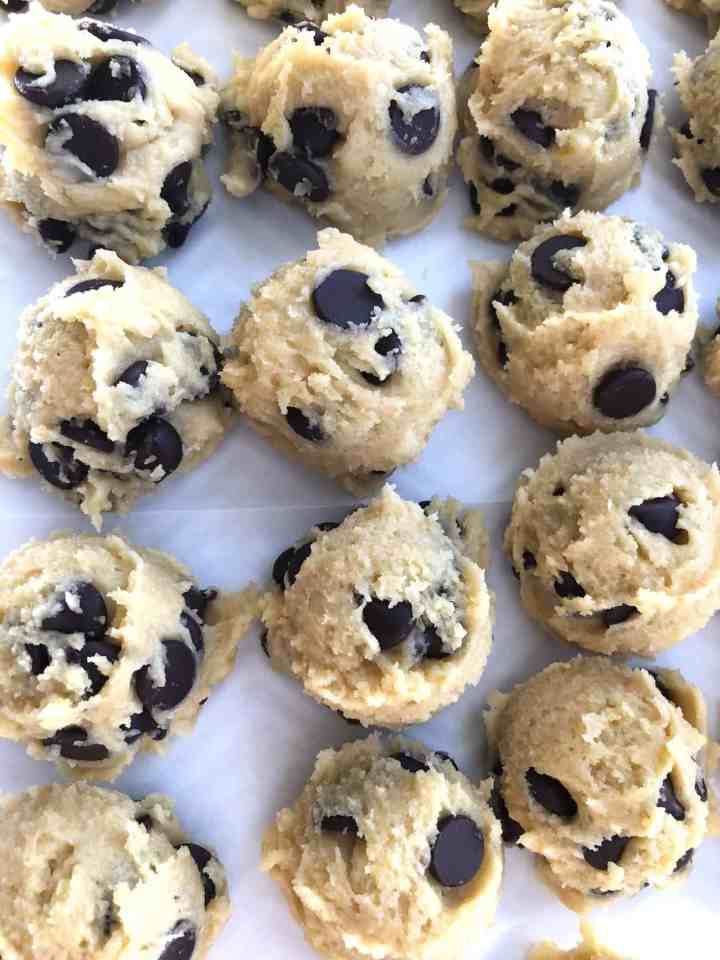 chocolate chip cookie dough on a tray ready to be frozen