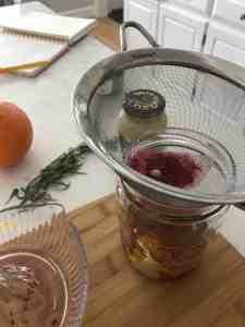 straining blood orange juice for vinaigrette