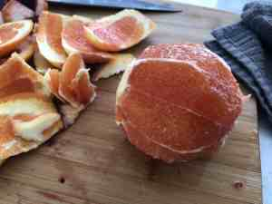 orange with skin removed ready to slice for salad