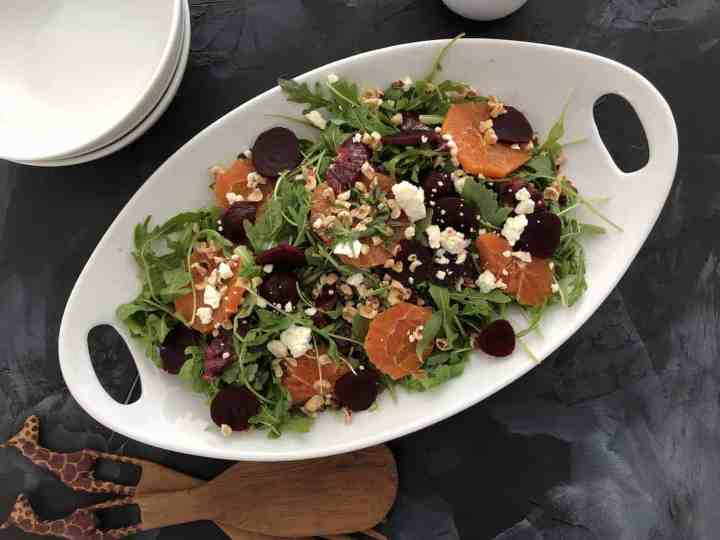 blood orange and beet salad on a platter ready to serve