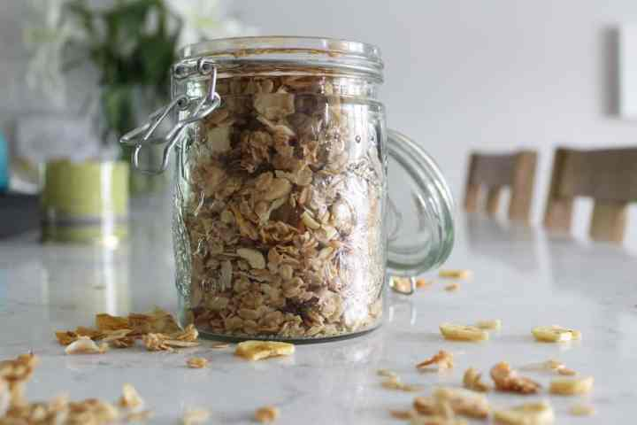 side view jar of pineapple macadamia nut granola