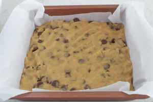 brown butter milk chocolate chips in parchment lined pan