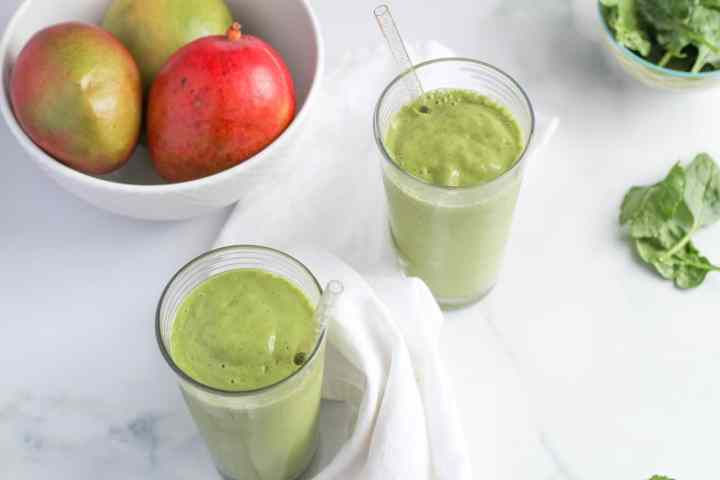 two tropical green smoothies on marble