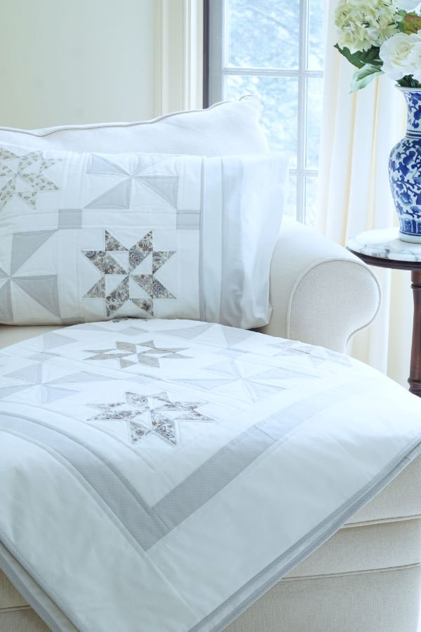 Stardust Shimmer Quilt displayed over chaise with Blue Vase