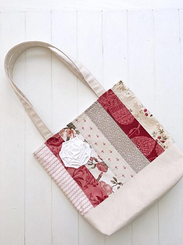 tote bag in a french country stye with beautiful applique of rose with striped fabric strips