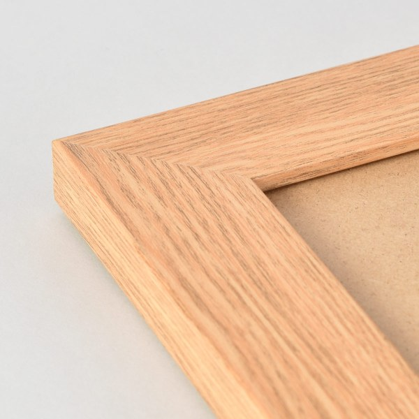 Freestyle light wood picture frame corner