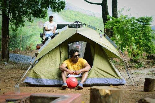 men in tent camping