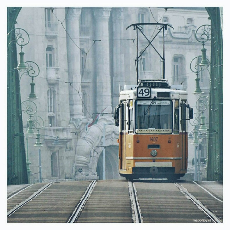 Old tram crossing bridge in Budapest - Map of Joy