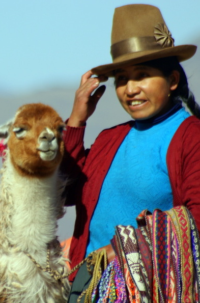 Local Peruvian Woman and Llama.