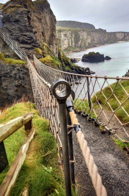 Suspended almost 100 ft above sea level, the rope bridge spans a dizzying gap over the North Atlantic from the mainland to a small island.