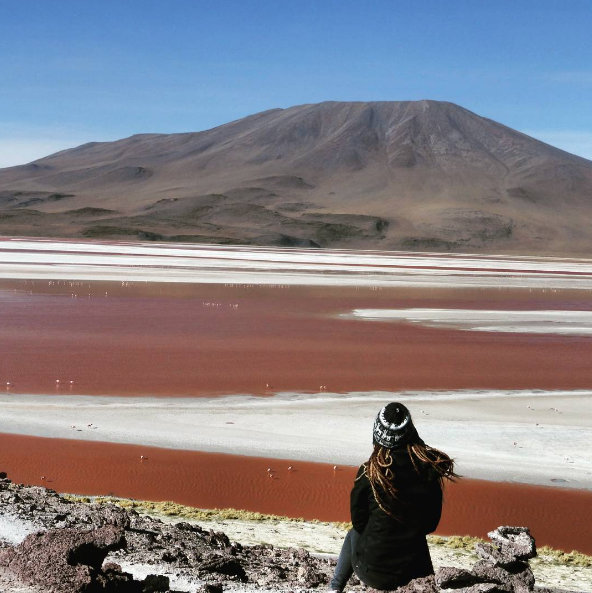 Red and white striped lake in the Atacama Desert, Chile. The colours are caused by algae blooms and mineral deposits.