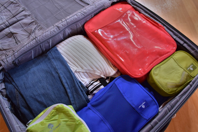 Instead of using disposable plastic bags when packing, it's far more environmentally friendly (and a lot easier to stay organized) to use packing cubes.