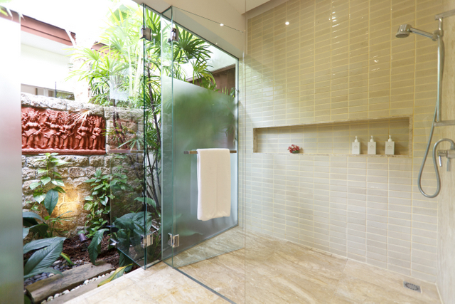 There is also an outdoor garden shower on stone wall if you don't want to track in sand from the beach.