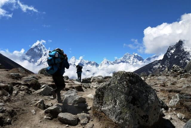 Porters trekking to Everest Base Camp