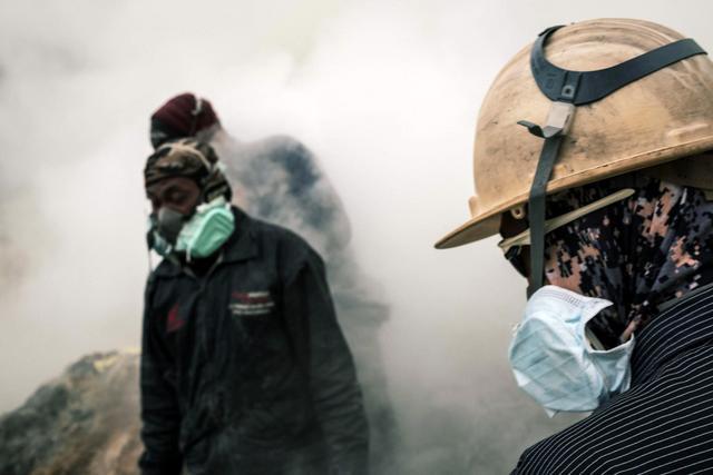 Sulfur Miners on Mount Ijen