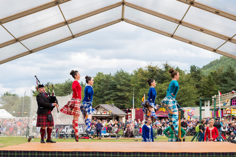 Highland dancers perform traditional Scottish dance at The Ballater Highland Games