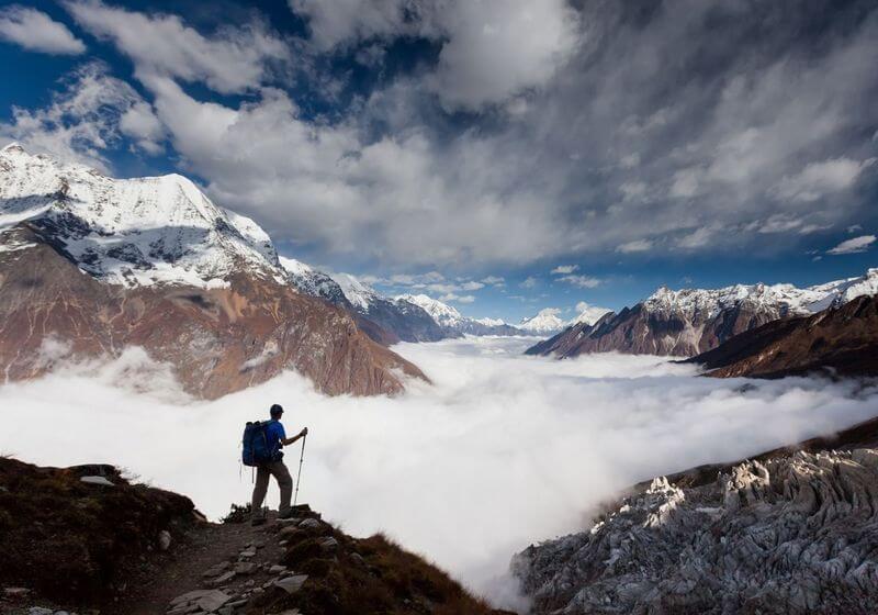 Manaslu Circuit Trek hiker clouds RF