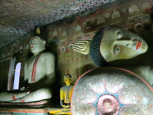 Sitting and reclining Buddhas inside Dambulla cave temple