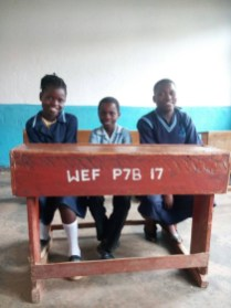 Three of the children Marajowi is sponsoring at school (Wukani education facility)