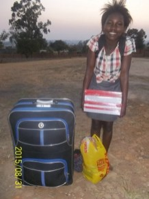 Notebooks, grocery, a big bag and a big smile is all the needful for school