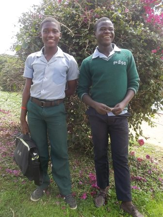 Witness and Ramos with the new school uniforms at Phewzi secondary school