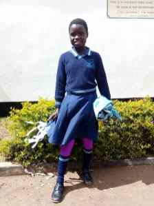 Katie with the school uniform
