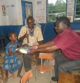 Malita donating the books